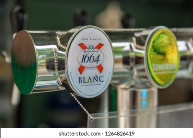 KIEV, UKRAINE - JULY 07, 2018: Kronenbourg Blanc beer and Somersby cider outdoor bar at the Atlas Weekend Festival in National Expocenter. The company is owned by the Carlsberg Group.
