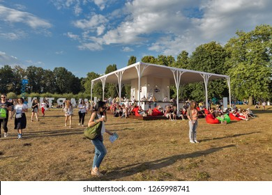 KIEV, UKRAINE - JULY 07, 2018: People visit Martini outdoor bar at the Atlas Weekend Festival in National Expocenter. Bacardi is the largest family owned spirits company in the world.