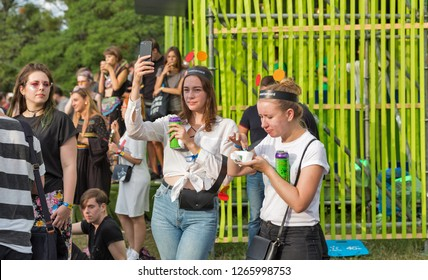 KIEV, UKRAINE - JULY 07, 2018: Young people visit Atlas Weekend Festival in National Expocenter. The Atlas Weekend is a popular annual modern music and arts festival.