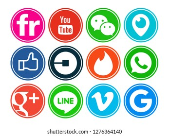 Kiev, Ukraine - July 07, 2018: Set of popular social media icons printed on white paper: Facebook, Google Plus, Flickr, YouTube, WeChat, Periscope, Uber, Tinder, WhatsApp, Line, Vimeo, Google.