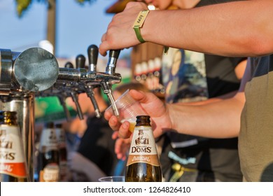 KIEV, UKRAINE - JULY 08, 2018: Bartenders work in Robert Doms beer outdoor bar at the Atlas Weekend Festival in National Expocenter. Robert Doms is one of Lvivske Ukrainian brewery brand names.