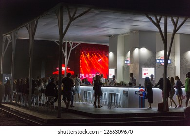 KIEV, UKRAINE - JULY 08, 2018: People visit Martini outdoor bar at the Atlas Weekend Festival in National Expocenter. Bacardi is the largest family owned spirits company in the world.