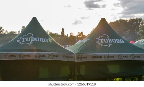 KIEV, UKRAINE - JULY 08, 2018: Tuborg beer outdoor bar at the Atlas Weekend Festival in National Expocenter. Tuborg is a Danish brewing company, part of Carlsberg Group.