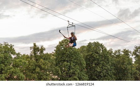 KIEV, UKRAINE - JULY 08, 2018: People ride aerial ropeway at Atlas Weekend Festival in National Expocenter. The Atlas Weekend is a popular annual modern music and arts festival.