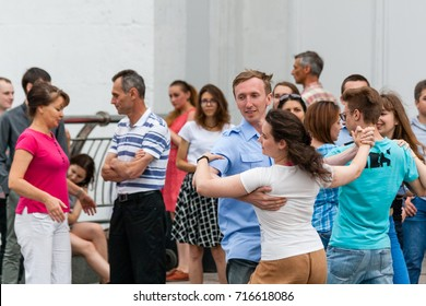 KIEV, UKRAINE - JULY 09, 2017: beautiful couple dancing on the street waltz close up