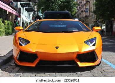 Kiev, Ukraine - July 1, 2012; Lamborghini Aventador on the streets. Car. Orange. City. Luxurious. Tuning. Supercar. Italy. Editorial photo.