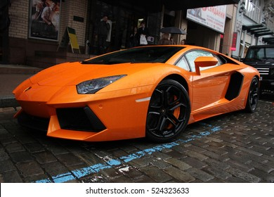 Kiev, Ukraine - July 1, 2012; Lamborghini Aventador on the streets. Car. Orange. City. Luxurious. Tuning. Supercar. The car in the rain. Raindrops. Italy. Editorial photo.