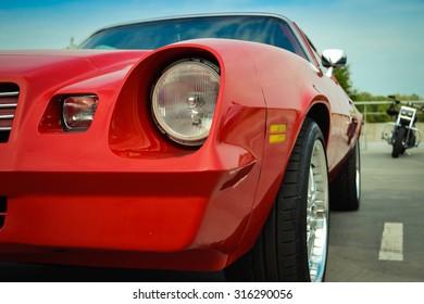 Kiev, Ukraine - July 15, 2015: Beautiful red retro Chevrolet in the parking lot. July 15, 2015. Kiev, festival USA in Ukraine