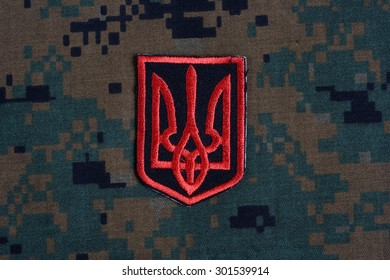 KIEV, UKRAINE - July, 16, 2015.  Ukraine Army uniform badge - trident - Emblem of Ukraine