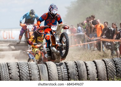 Kiev, Ukraine - July 16, 2017: Motocross riders compete with each other on dirt bikes, during Championship of Ukraine on cross-country final stage.