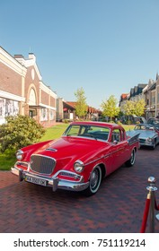 Kiev, Ukraine- July 16, 2017: a red retro Studebaker. Event of the classic cars. Beautiful retro cars at the exhibition. Vintage auto show. American ancient car parked at the street.
