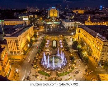 KIEV, UKRAINE - July 16, 2019: Drone view of the the city center at night. Top view of the Independence Maidan at Kiev, Ukraine.