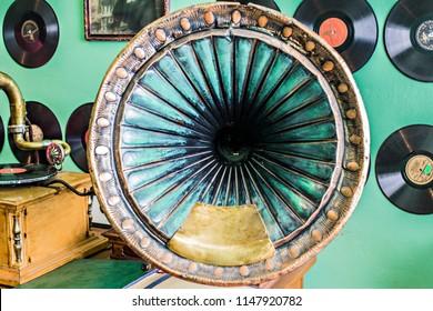 KIEV, UKRAINE - July 2017: Flea market in Kiev. Old vintage used electronics: retro turntable, gramophone, phonograph records for sale on secondhand market in Kiev, Ukraine