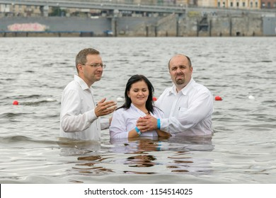 Kiev, Ukraine. July 22 2018 Two pastors baptize girl