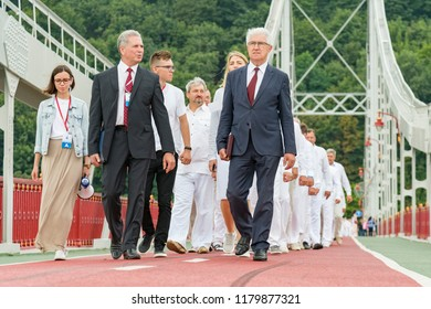 Kiev, Ukraine. July 22 2018 Two shepherds lead a column of believers in white robes for water baptism. The column of converts of Christians go to receive water baptism.