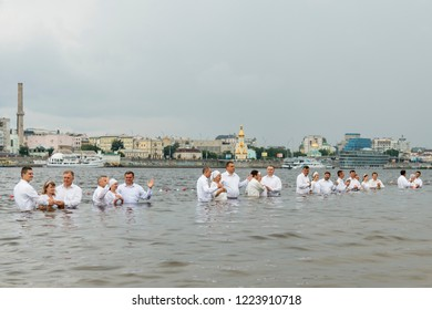 Kiev, Ukraine. July 22 2018 Pastors baptize people in the river. Mass water baptism on the beach.