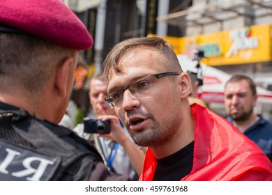 KIEV, UKRAINE - JULY 27, 2016 : Detention of a member of the volunteer battalion Sich national police during religious procession parishioners Ukrainian Orthodox Church Moscow Patriarchate