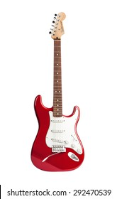 KIEV, UKRAINE - JULY 28, 2014: red six-stringed electric guitar Fender Stratocaster isolated on white