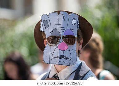 """KIEV, UKRAINE - JULY, 3, 2015: Activists wearing """"Vatnik"""" masks represent Russian artists who are known for their anti-Ukrainian stance as protest against broadcasting of Russian shows"""