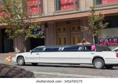 Kiev, Ukraine - July 30, 2017: Rented luxury white limousine on a city street