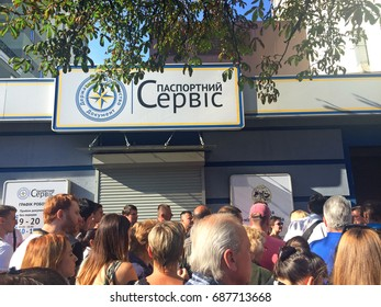 KIEV, UKRAINE - JULY 31,  2017: Many people stand in line to fill documents for obtaining a biometric passport to visit Europe without a visa
