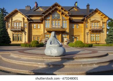 KIEV, UKRAINE - July 4, 2017: Contemporary sculpture Homunculus Loksons in the residence Mezhyhirya. The doctor's expectation concept