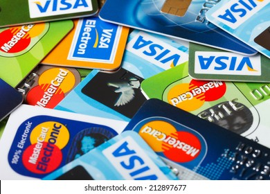 KIEV, UKRAINE - July 7: Pile of credit cards, Visa and MasterCard, credit, debit and electronic, in Kiev, Ukraine, on July 7, 2014.