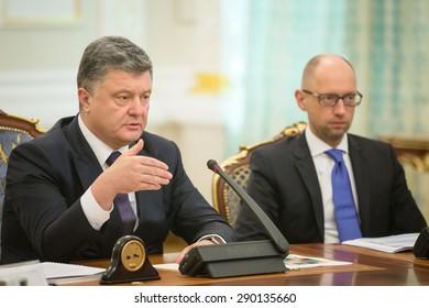 KIEV, UKRAINE - Jun 23, 2015: President of Ukraine Petro Poroshenko and the Prime Minister of Ukraine Arseniy Yatsenyuk during a meeting of the National Council of the reforms in Kiev