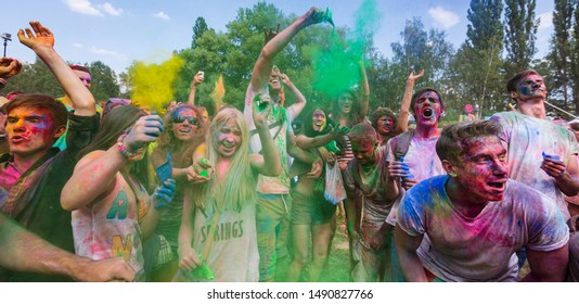 KIEV, UKRAINE - Jun 25, 2016: Holi colors holiday. Crazy crowd of young people having fun during festival of colors ColorFest