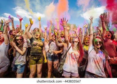 KIEV, UKRAINE - Jun 25, 2016: Crowd of happy young people have fun in colors during festival of colors ColorFest