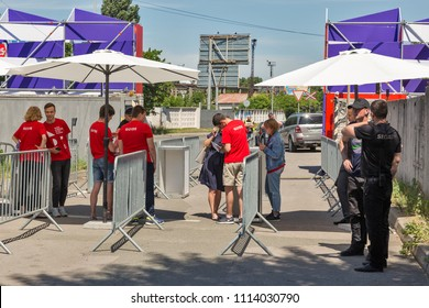 KIEV, UKRAINE - JUNE 02, 2018: Security and guide staff works at Kyiv Wine Festival checkpoint. Festival of wine and healthy food was organized by Good Wine company, 77 winemakers took part there.