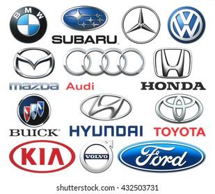 Kiev, Ukraine - June 03, 2016: Collection of popular car logos printed on white paper: Volkswagen, Audi, Subaru, Mazda, Hyunday, Toyota, Kia, Volvo, Ford and others