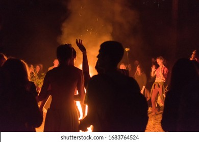 Kiev, Ukraine, - June 03, 2018: A lot of people around the fire at night at the festival.