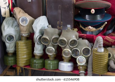 Kiev, Ukraine - June 04, 2016: Gas masks and a Soviet military uniform on the flea market counter on Andreevsky Descent