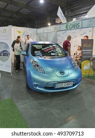 KIEV, UKRAINE - JUNE 10, 2016: Visitors visit BLS car rental booth with Nissan Leaf electric hybrid car on display at 1st International Trade Show of Electric Vehicles Plug-In in KyivExpoPlaza Center