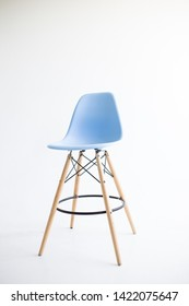Kiev, Ukraine - June 10, 2019: Blue wooden chairs for the legs on a white background. White cyclorama in the studio. Isolated.
