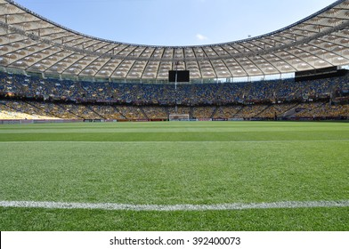 KIEV, UKRAINE, JUNE 11, 2012, View from the Green Field, White Line, Yellow Blue Empty Tribune Seats, Roof, Olympic Stadium, European Football Championship on a Match Day, Sky, Documentary Editorial