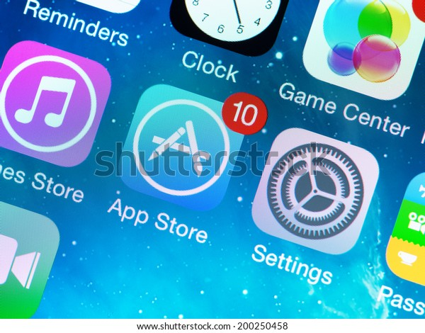 KIEV, UKRAINE - JUNE 12, 2014: A close-up photo of Apple iPhone 5s start screen with apps icons. App Store is a digital distribution service for mobile apps on iOS platform, developed by Apple Inc.