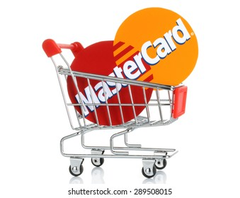 KIEV, UKRAINE - JUNE 12, 2015: Mastercard logo printed on paper and placed into shopping cart. MasterCard Worldwide is an American multinational financial services corporation