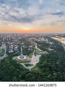 Kiev, Ukraine - June 12, 2019: Panorama of the city of Kiev, the capital of Ukraine. Panorama of Kiev in a warm summer evening at sunset with shades of orange. Photo of Kiev from the drone, a bird's