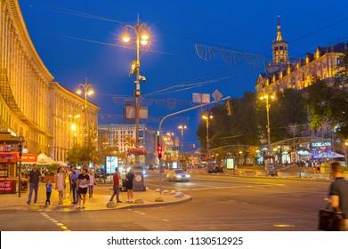 KIEV, UKRAINE - JUNE 13, 2018: People walking by Khreschatyc street. Khreshchatyk is the main street of Kiev - the capital of Ukraine.