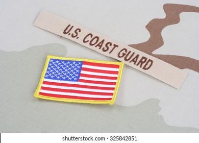 KIEV, UKRAINE - June 14, 2015. US COAST GUARD branch tape with flag on desert camouflage uniform