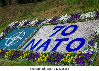 "KIEV, UKRAINE - JUNE 15, 2019, flowerbed on the European Square with the congratulatory inscription ""NATO 70"". The concept of NATO is security."