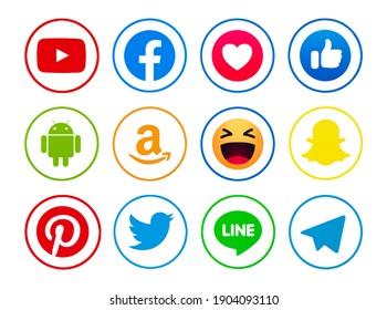 Kiev, Ukraine - June 15, 2020: New Facebook, like button  Empathetic Emoji reactions, Pinterest,  Snapchat,Android,Pinterest,   Twitter, Telegram, Line, YouTube, printed on paper.