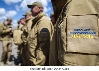 """KIEV, UKRAINE - June 16, 2016: Employees of """"fish patrol"""" inspect the river in search of poachers in Kiev, Ukraine. Fishguard patrol - body for proper use and reproduction of aquatic bioresources."""