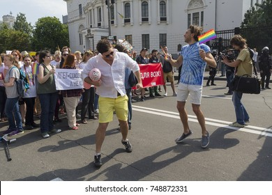 Kiev, Ukraine - June 18, 2017: Participants of the gay parade relaxed under the protection of the police