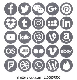 Kiev, Ukraine - June 19, 2018: Collection of popular gray round social media icons, printed on paper: Facebook, Twitter, Google Plus, Instagram, Pinterest, Linkedin, Amazon and others.