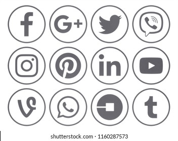 Kiev, Ukraine - June 19, 2018: Collection of popular gray round social media icons with rim, printed on paper: Facebook, Instagram, Twitter, Google Plus, Pinterest, LinkedIn, Tumblr and others