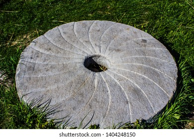 Kiev / Ukraine / June 19, 2018 Photo of a large stone millstone from the mill