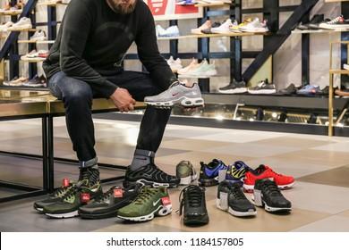 Kiev / Ukraine - June 20 2018: Nike store. Man buys sneakers Nike Air Max